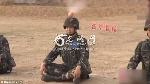 In the footage two of the soldiers are successful in shooting the apples