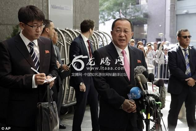 North Korea's Foreign Minister Ri Yong Ho centre speaking through an interpreter left talks outside the UN Plaza Hotel in New York today