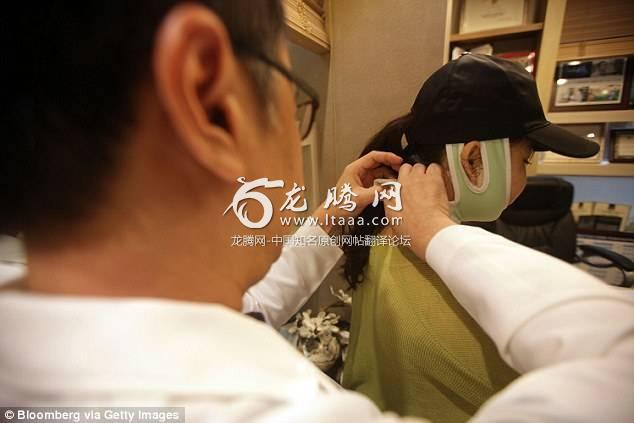 It's said that 99000 Chinese tourists went to South Korea to undergo plastic surgery in 2016. In the file photo a plastic surgeon checks a patient's post-operation condition in a consultation room at the clinic in Seoul South Korea
