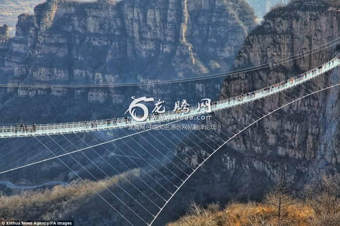 Don't look down! The 1601-foot-long glass-bottomed bridge opened on December 24 in the Hongyagu Scenic Area in China