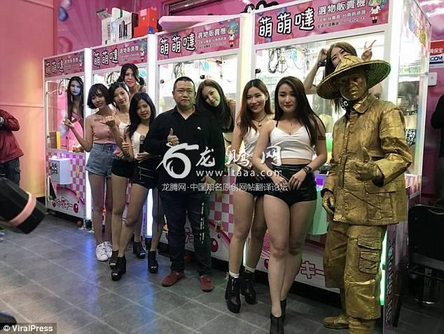 The models line up in hot pants next to the arcade machines they ended up inside at the attraction
