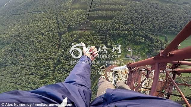 Relaxed: Alex Nomernoy 19 ascends the huge operating tower in Russia with no safety equipment giving a thumbs up to the camera when he reaches the top