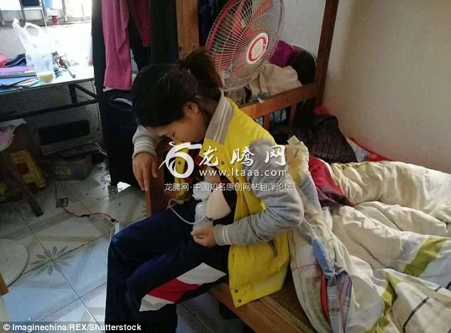 Ms Tang also sells her breast milk in bags to passersby in Shenzhen. The woman a migrant worker is pictured pumping breast milk at her tiny £79-per-month rental flat