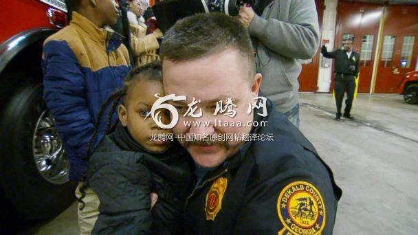 PHOTO: Destiny Nelson 5 reunites with Captain Scott Stroup of the Dekalb County Fire Rescue Department the man who caught her when she was thrown to safety from the balcony of a burning apartment building. (ABC News)