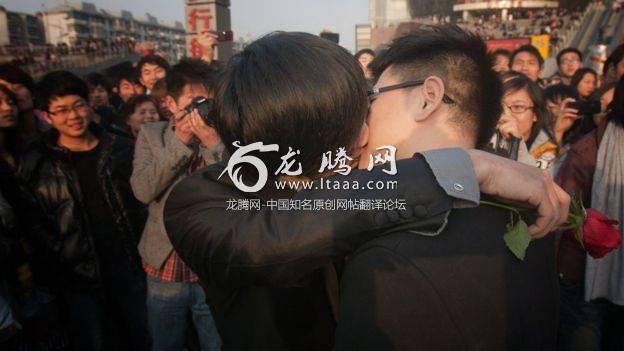 In a picture taken on 8 March 2011 a gay couple kiss during their ceremonial 'wedding' as they try to raise awareness of the issue of homosexual marriage in Wuhan in central China's Hubei province.