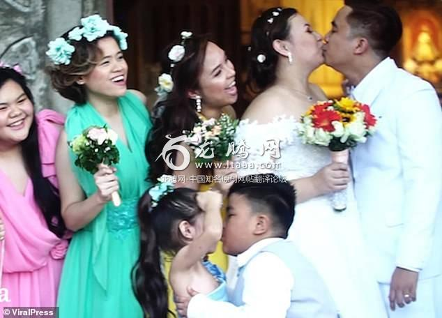 Mayco was filmed planting a kiss on flower girl Sheyn Buencamino's cheek stealing the limelight from the bride and groom