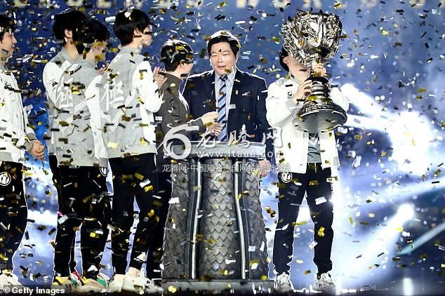 Wang Sicong's team Invictus Gaming celebrates their winning after the final match of the 2018 League of Legends World Championship in Incheon South Korea on Saturday