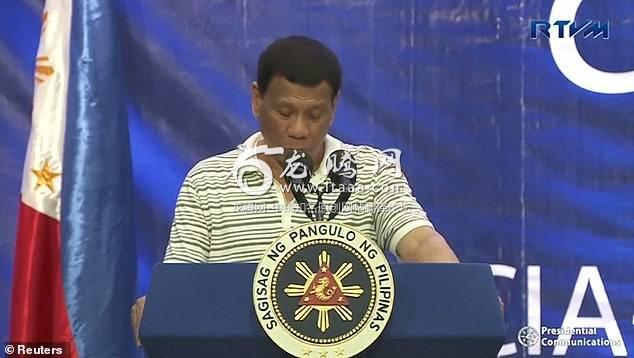 The cockroach appears on President Duterte's shoulder while he is speaking to supporter at a rally for the Philippine's midterm elections